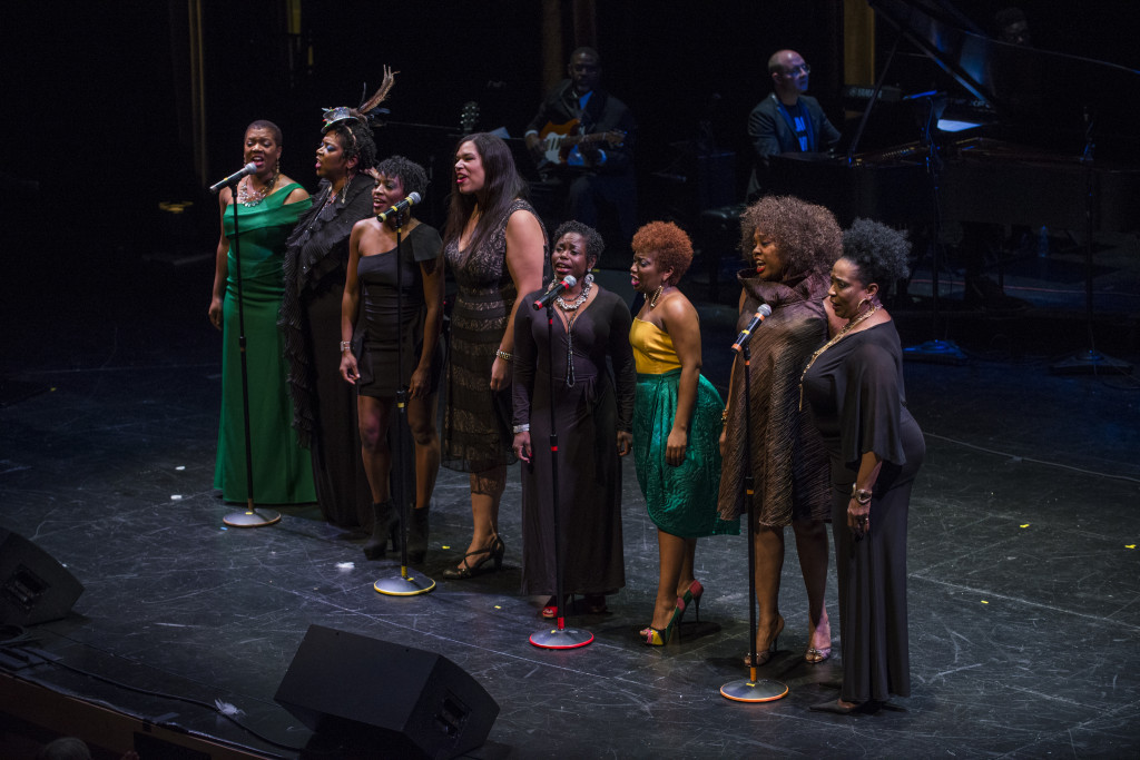 (From L to R) Lili-Anne Brown, Lynne Jordan, Monique Haley, Bethany Thomas, Karla Beard-Leroy, Alexis J. Rogers, Dee Alexander, and E. Faye Butler singing Four Women at the Chicago Humanities Festival production of Four Women on Monday, Nov. 2 at Francis W Parker School, as part of the 2015 Fall Festival, Citizens. Photo by Michael Brosilow.